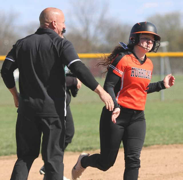 Harlie Bickett is congratulated by WHS coach Brian Spurlock Monday following her fifth homerun of the season. (Courtesy Photo)