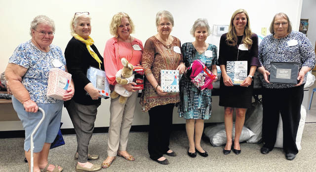 Clinton County Homemakers Club recently held their 2019 Spring Awards Banquet. After dinner and recognition of council members, President Judy Grosvenor presented a gift of $700 and bedding donations to Carrie Zeigler, President of Sleep in Heavenly Peace in Clinton County.