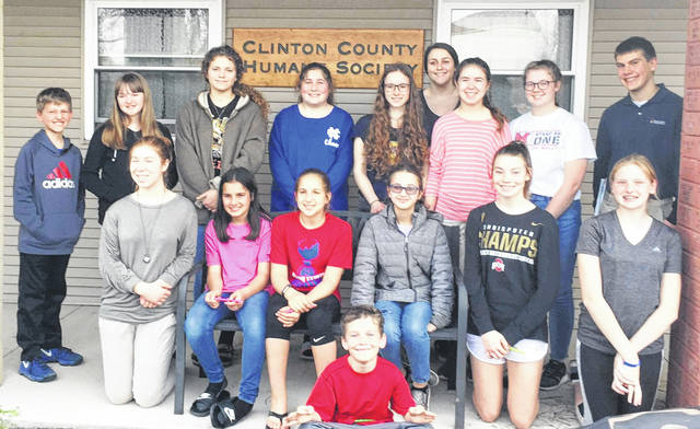 In recognition of National Volunteer Week, the Clinton County Cookie Cutters 4-H Club met at the Clinton County Humane Society on Monday. Eighteen members and three advisors toured the facility and learned about services provided. Volunteers must be 18 or older, and are needed regularly to cover feeding, cleaning and animal care for morning and afternoon shifts. Parents and kids may be eligible to volunteer together if they can commit to a regular schedule. The Humane Society offers spay and neuter services as well as adoptions of cats and dogs. 4-H members presented the shelter with dog and cat toys they made at a recent meeting, as well as supplies of liquid laundry detergent, bleach, and paper towels. Shown are, from left: front, Will Lawson; middle row, Emily Brausch, Jace Lawson, Baylie Wulf, Katie Synan, Abbey Steed and Mackinzie Miller; back row, Hayden Franek, Flora Franek, Liza Duncan, Delaney Warnock, Elisa Mueller, Jenn Callewaert, Maddie Brausch, Anna Garnai and Michael Shobe.