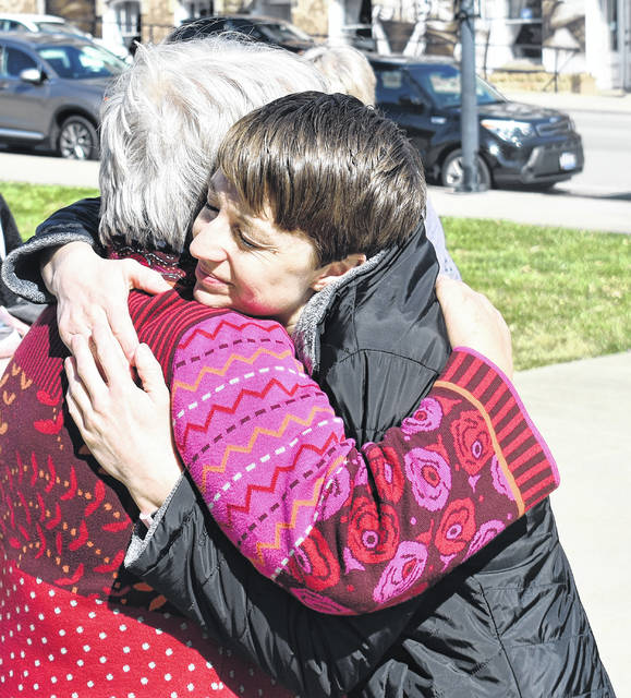Kerrie Fahey, right, gets a hug from Quaker Pastor Nancy McCormick at the Clinton County Courthouse on Wednesday during a prayer vigil for her daughter, 14-year-old Alaina Quillin.