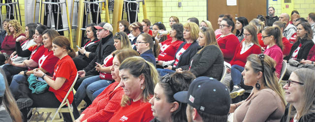 Blanchester school staff members wear Red for Ed shirts in support of public schools during Monday's Blanchester School Board meeting.