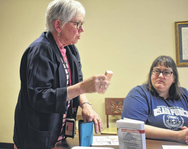 Barbara Adams Marin, a prevention supervisor from Solutions, talks to Sabina area residents about what can be found in a take-home Narcan kit provided by Project DAWN during a Narcan training session Tuesday at Sabina United Methodist Church.