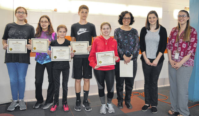 The Wilmington Middle School Math Club was recognized at the school board meeting. Members present for the photo are, from left, Jocelyn Engel, Kayla Davis, Mia Skinner, Preston Zeigler and Katie Pittman, and teacher-sponsors Mrs. Haberlandt, Ms. Wiles and Ms. Steinmetz.