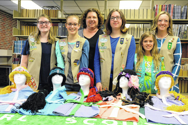 Members of Girl Scout Troop 31030 who made Princess Wigs, and their adult leaders, are, from left, Ella Neuenschwander, who made Sleeping Beauty; Vanessa Calderone, The Little Mermaid; Dr. Laura Struve; Jocelyn Engel, Moana; Veronica Calderone, Rapunzel; and Dr. Marta Wilkinson. Not pictured is Brianna Brunke, who made the Princess Jasmine wig.