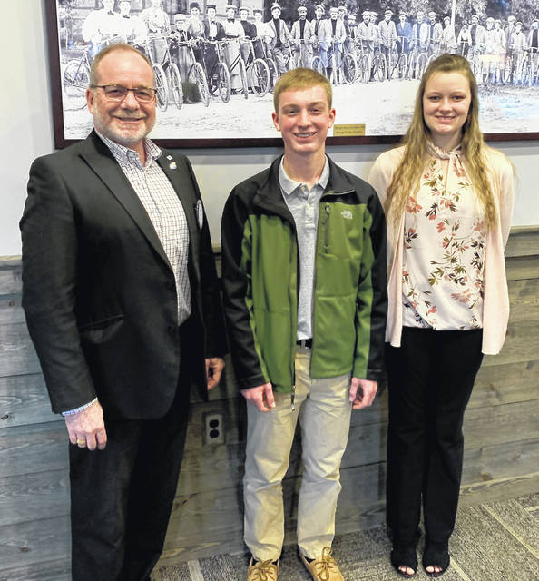 Logan Fisher from Clinton-Massie High School and Jazmin Carrico from East Clinton High School were Students of the Month recognized by the Wilmington Rotary Club. They are with Club President Dan Evers.
