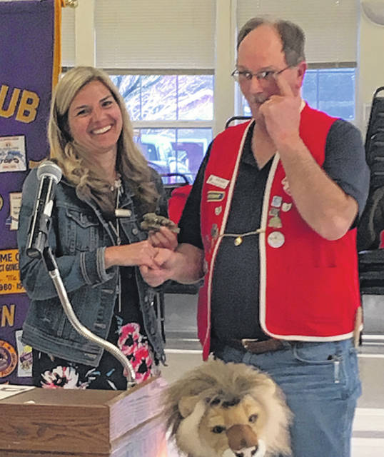 At the Monday night Lions Club meeting, Carrie Zeigler is given a Lions statuette by Club President Lion John Hibbs. Carrie talked about the Sleep in Heavenly Peace organization and how it provides twin-sized bunk beds for local children who don't have beds to sleep in; many often sleep on the floor. The Clinton County chapter has recently been added to the nationwide group of 127 chapters in 39 states. The club was asked to help support this project which continuously becomes aware of more and more children needing their help. In addition to the bed frames, mattresses and bedding are also provided for each child.