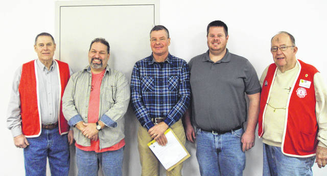 The New Vienna Lions Club recently inducted two new members into its organization during a brief ceremony in the town's community room. Steve Moore and Randy Ubry-Terrell, along with their sponsors were congratulated by other club members. Steve is a full-time farmer in the New Vienna area, and a graduate of The Ohio State University. Randy is a native of California and is employed by the East Clinton School District as a cook for the high school and middle school. Shown, sponsor Tom Terrell (left) stands beside new member Randy Ubry-Terrell, along with incoming member Steve Moore, Club President Brad Hughes, and Lions Zone Chairman Jim Georges.