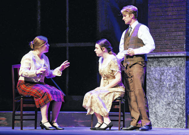 "Wilmington College Theatre will present ""Radium Girls"" Thursday, Friday and Saturday at 7:30 p.m. in Heiland Theatre. The show looks at the American obsession with health, wealth and the commercialization of science. Pictured from left, the chairwoman of the Consumers League, Katherine Wiley, played by Ariana Riccardi, takes on the case of radium poisoning for Grace Fryer (Riley Gatlin) as Grace's fiancé, Tom Krieder (Gage Clemens) looks on."