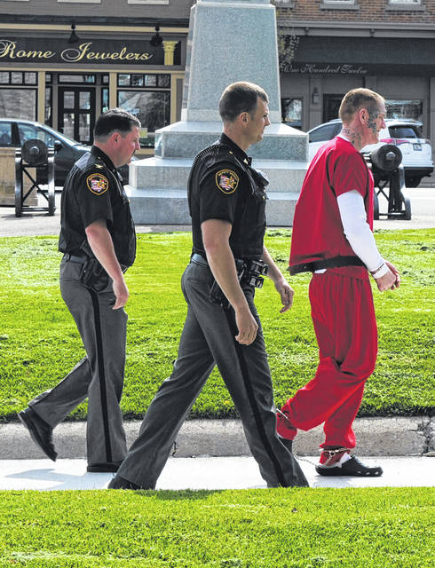James Carver, right, walks to the Highland County Courthouse on Wednesday. He is accompanied by Chief Deputy Brandon Stratton, left, and Sgt. Craig Seaman, center, both of the Highland County Sheriff's Office.
