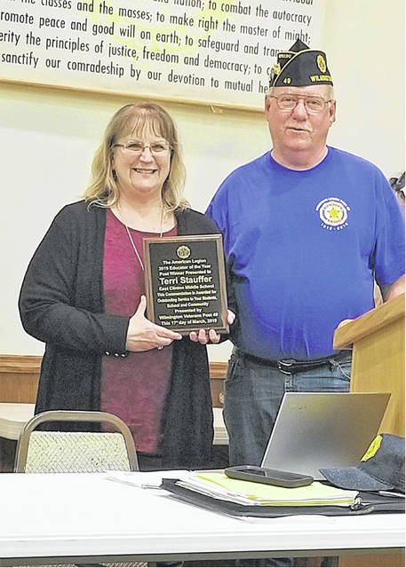 Wilmington American Legion Post 49 Adjutant Brady Stevens presents a plaque to Terri Stauffer, from East Clinton Middle School, for her selection as Post Educator of the Year. Terri was also selected as the American Legion 4th District Educator of the Year and will now go on to compete at the state level.