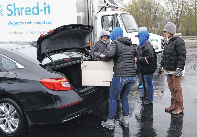 The fourth annual Community Shred-It Day was held on a damp, cold Saturday morning at the Wilmington High School parking lot, sponsored by Wilmington City Schools and Wilmington Savings Bank. Shown are volunteers from Wilmington Savings Bank as well as members of the Wilmington High School Rotary Interact Club.