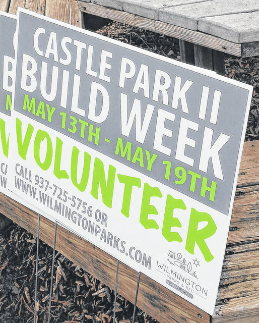 These signs are around town encouraging residents to volunteer during Castle Park II build week May 13-19.