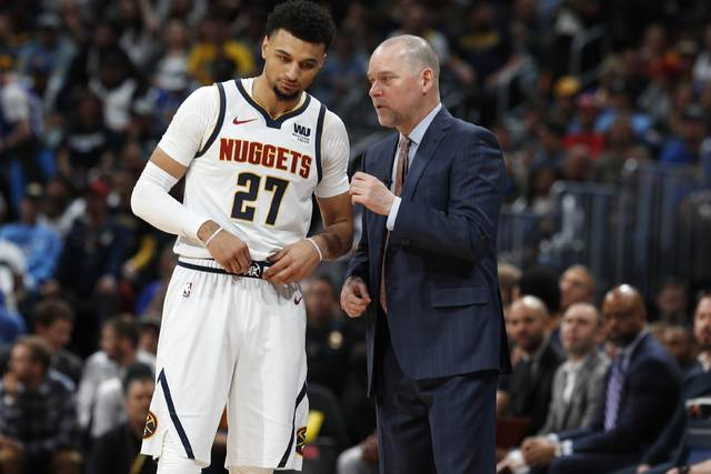 Denver Nuggets head coach Michael Malone, right, confers with guard Jamal Murray during a break in the action against the Portland Trail Blazers in the first half of Game 1 of an NBA basketball second-round playoff series Monday, April 29, 2019, in Denver. (AP Photo/David Zalubowski)