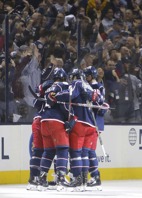 Columbus Blue Jackets players celebrate their goal against the Boston Bruins during the first period of Game 3 of an NHL hockey second-round playoff series Tuesday, April 30, 2019, in Columbus, Ohio. (AP Photo/Jay LaPrete)