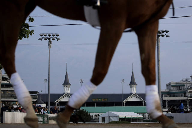A horse is ridden to the track for a workout at Churchill Downs, Wednesday, May 1, 2019, in Louisville, Ky. (AP Photo/Charlie Riedel, File)