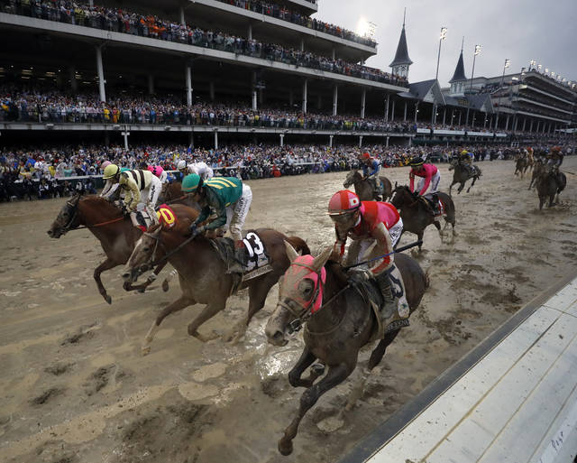 Flavien Prat ride Country House, left, to the finish line during the 145th running of the Kentucky Derby horse race at Churchill Downs Saturday, May 4, 2019, in Louisville, Ky. Country House was declared the winner after Maximum Security was disqualified following a review by race stewards. (AP Photo/Matt Slocum)