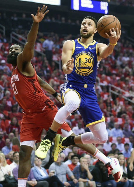 Golden State Warriors guard Stephen Curry (30) drives to the basket as Houston Rockets guard James Harden defends during the first half of Game 4 of a second-round NBA basketball playoff series, Monday, May 6, 2019, in Houston. (AP Photo/Eric Christian Smith)