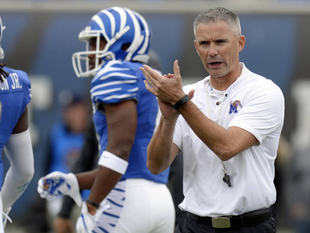 FILE - In this Oct. 13, 2018, file photo, Memphis head coach Mike Norvell watches players warm up before an NCAA college football game against Central Florida, in Memphis, Tenn. The portal is the NCAA's cryptic name for the database it maintains to track which athletes, in all sports, have notified their schools they wish to transfer. (AP Photo/Mark Zaleski, File)