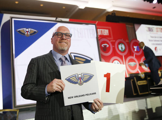David Griffin, New Orleans Pelicans executive vice president of basketball operations, holds up placards after it was announced that the Pelicans had won the first pick during the NBA basketball draft lottery Tuesday, May 14, 2019, in Chicago. (AP Photo/Nuccio DiNuzzo)