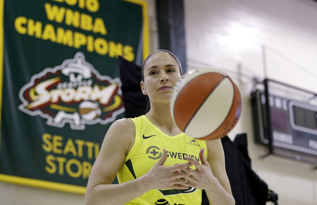 Seattle Storm's Sue Bird tosses a basketball as she waits to be photographed at the basketball team's media day Monday, May 13, 2019, in Seattle. The Storm is the defending WNBA champion. (AP Photo/Elaine Thompson)