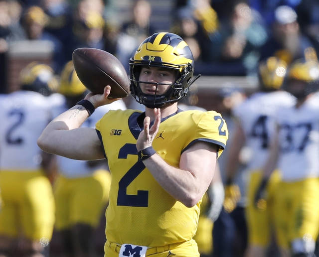 In this April 13, 2019, photo, Michigan quarterback Shea Patterson throws during the Michigan's annual spring NCAA college football game in Ann Arbor, Mich. A string of recent high-profile transfers gave the college football world the impression it was getting easier for players to switch schools and compete right away. Patterson to Michigan, Justin Field to Ohio State and Tate Martell to Miami seemed to usher in a new era of free agency, but waiver approvals are still far from a sure thing. That is prompting athletes, coaches and others to complain about a process that can be somewhat mysterious. (AP Photo/Carlos Osorio)