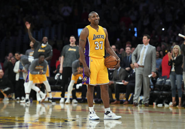 FILE - In this Tuesday, April 11, 2017, file photo, Los Angeles Lakers forward Metta World Peace stands on the court while teammates and fans cheer as the 24-second clock runs out near the end of the team's 108-96 victory against the New Orleans Pelicans in an NBA basketball game in Los Angeles. Metta World Peace needed to win a championship ring so his career wasn't defined only by one angry moment in Detroit. (AP Photo/Mark J. Terrill, File)