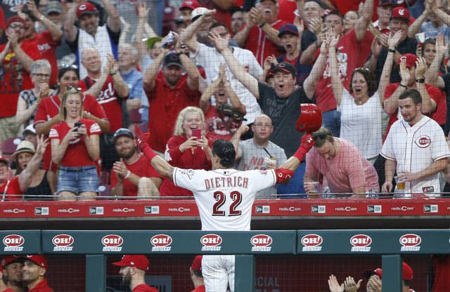 Cincinnati Reds' Derek Dietrich (22) acknowledges the fans following a two-run home run off Pittsburgh Pirates relief pitcher Geoff Hartlieb, his third of the game, during the seventh inning of a baseball game, Tuesday, May 28, 2019, in Cincinnati. (AP Photo/Gary Landers)