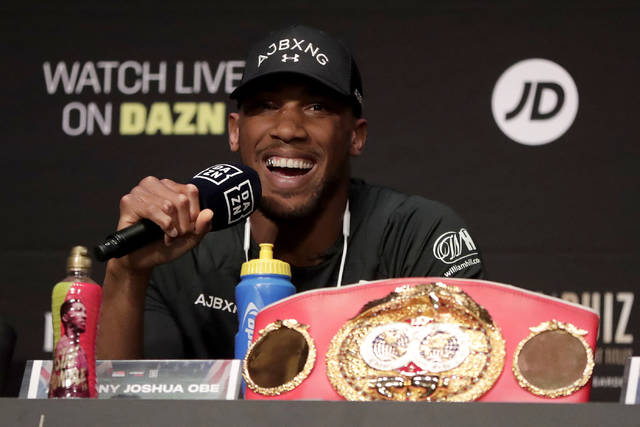 British boxer Anthony Joshua answers a question during a press conference ahead of his heavyweight bout against Andy Ruiz, Thursday, May 30, 2019, in New York. Joshua will defend his WBA, WBO and IBF heavyweight titles. (AP Photo/Julio Cortez)