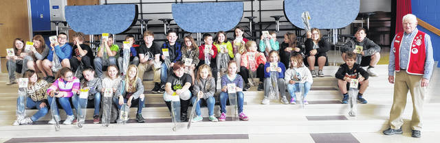For the seventh consecutive year, the Wilmington Lions club has participated in observing Arbor Day in Ohio. This year the Lions Club purchased 650 blue spruce saplings for all of Clinton County's fourth-grade students. The club works with the Fourth Grade Foresters USA of Lincoln, Nebraska. Shown in the picture are some of Clinton-Massie's fourth-graders with Lions member Gene Snyder, who made the program presentation and distributed the trees.