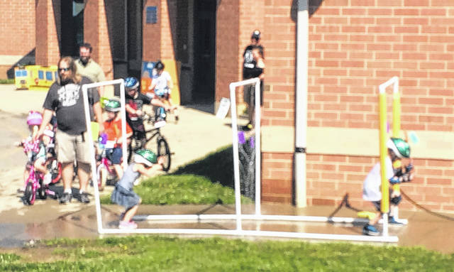Blanchester kids got to wash their bikes in a fun during Blanchester's Bike Rodeo at Putman Elementary School on Saturday.