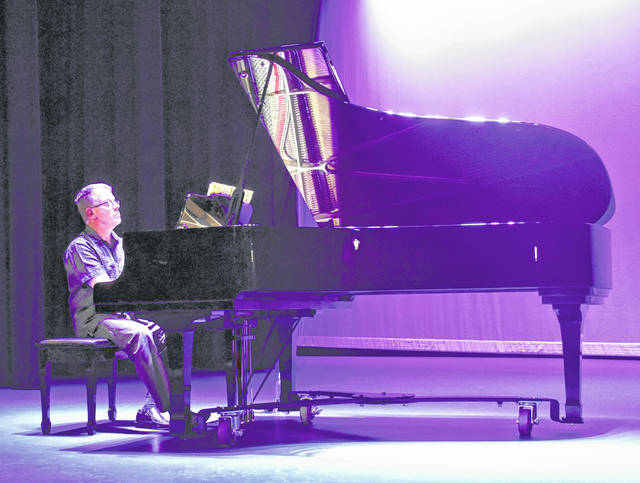 Timothy Larrick, the Murphy Theatre's Artistic Director, plays the new piano donated by the Leland Foundation. The Yamaha C7 was donated to the theatre in memory of George Leland.
