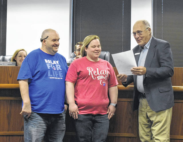 From left, Ben Hunter and Tonya Fausnaugh stand with Mayor John Stanforth at Thursday's Wilmington City Council meeting where he proclaims June 22 as Relay for Life Day. This year's event will begin at 11 a.m. that day at J.W. Denver Williams Jr. Memorial Park. For more information, visit http://bit.ly/2w6tT8g .