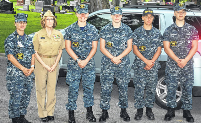 From left, D. Kaleta, LCDR S. Lukasiewicz, PO3 S. Kaleta, SN A. Ross, SR J. Kaleta, and AN A. Longano from the Naval Sea Cadet Corps in Cincinnati came up to help place flags at veterans' graves at Sugar Grove Cemetery on Sunday.