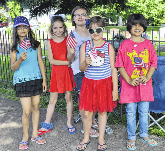 Youths show their their pride in the red, white & blue during last year's parade in Wilmington.