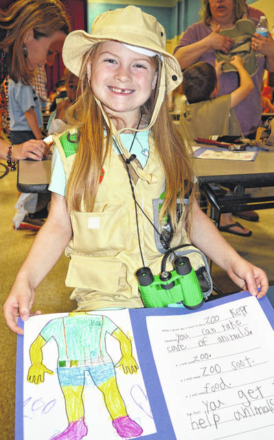 Adalynn wants to be a zookeeper in order to help animals. With her outfit and binoculars, she looks the part. She is a kindergarten student at Holmes Elementary.
