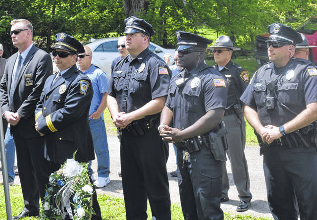 Police officers, their families, and local officials and residents pay respects to Wilmington Police Department Patrolman Emery McCreight and Marshal John T. Van Doren — who were killed in the line of duty in 1922 and 1884, respectively — at a ceremony in Sugar Grove Cemetery on Wednesday. The now-annual ceremony takes place on May 15 — the national Peace Officers Memorial Day. For more photos, visit wnewsj.com.