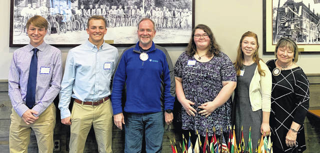 Shown are students Brennen Swope and Benjamin McAllister; Rotary President Dan Evers; students Alexandria Turner and Emily Brausch. and Cindy Camp, Scholarship Committee Chairperson.
