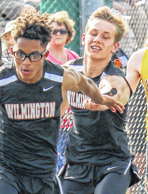 Carter Huffman (right) and Malik Scott are on two of the WHS relays that advanced to the finals Friday at the Division I Bellbrook District Track & Field Championship meet.