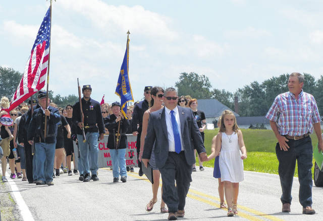 The annual Lees Creek Memorial Day parade was held Monday, which included members of Co. C, 20th Ohio Volunteer Infantry Sons of Veterans Reserve, the East Clinton Band as well as local officials and State Rep. Shane Wilkin (left) who led the parade with Wayne Township Trustee Kevin Bean (right) from the township hall in Lees Creek to the cemetery about a quarter mile away.