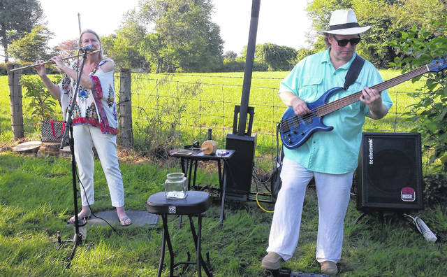 This year's Dinner in the Fields — like last year's (shown) held at Hillyard Farm owned by Craig and Becky Strafford in New Vienna — will feature locally cooked and grown food, the pie auction and entertainment for all.