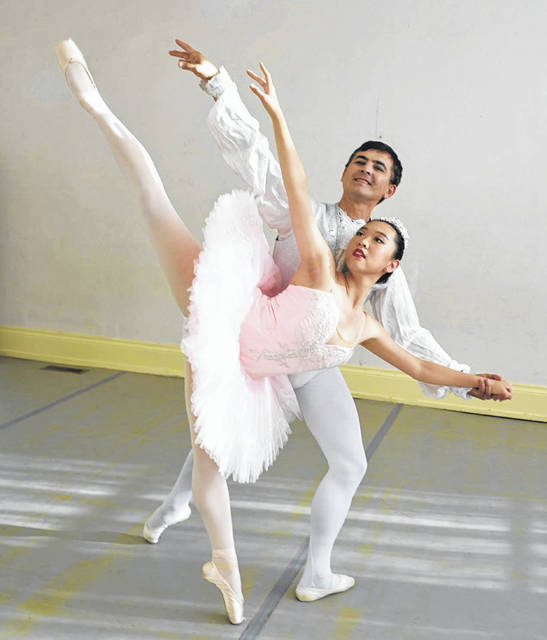 Carolyn Zhang and Sergei Pakharev represent ballet tech of ohio in this classic Swan Lake pose.