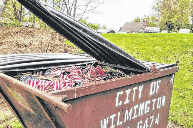 Flags were removed from veterans' graves in April and placed in the Sugar Grove Cemetery dumpster.