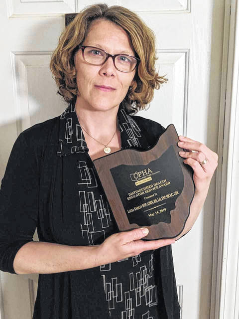 The CCHD's Laura Knisley earned the Ohio Distinguished Health Educator Service Award from the Ohio Public Health Association.