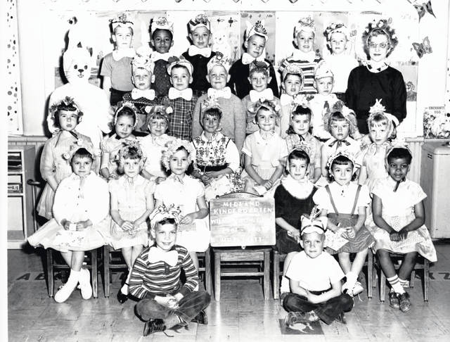This photo is of a Midland kindergarten class of 1961-62. According to the back of the photo, shown are — and please excuse any spelling errors; the writing is cursive and fairly faint — seated on floor, Rodney West and Drew Foppe; first row, Paulette Taulbee, Debbie Cooper, Peggy Vandervort, Sharon Bridges, Theresa Guzzi and Tressa Todd; second row, Jeannie Rice, Nancy Middleton, Debbie Harland, Kim Green, Elaine Cardwell, Kimberle Ward, Joette Kersey and Betty Brown; third row, The Bunny (Mrs. Middleton), Chuckie Hunt, Steven Rose, Joe Kendall, Danny Curliss, Robert Peelle and Dickie Hoefbaum; fourth row, Kyle Lundy, Ronald Heard, John Groves, Kenny Yeakley, Andy Behymer and Steve Gray. The photo is courtesy of the Clinton County Historical Society. The Clinton County History Center is now open Saturdays 10 a.m.-2 p.m. For more info, visit www.clintoncountyhistory.org; follow them on Facebook @ClintonCountyHistory; or call 937-382-4684.