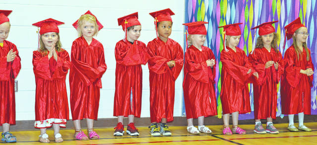 It's that time of year — commencement ceremonies for college, high school and, yes, preschool milestones. Pictured are afternoon preschool students of Sabina Elementary teacher Joan Arnold. They are moving on in their education, some to kindergarten and others to another year of preschool if they won't be old enough for kindergarten in August. Certificates were handed out to the children after they walked across a small bridge that had steps. Afterward, punch and cookies were provided for the occasion.