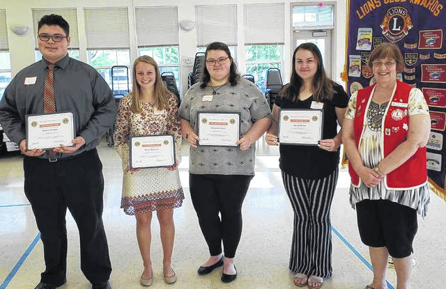 Four Clinton County high school seniors were each presented with a $1,500 scholarship award at the Monday night Wilmington Lions Club meeting. These awards will be paid to the colleges they will be attending. Shown from left are: Michael Alex Flanigan, Wilmington; Allison Houseman, Clinton-Massie; Alexandria Nicole Turner, East Clinton; Calleigh Hixson, Blanchester; and Lions member Kathey Carroll, Club Scholarship Committee Chairperson.
