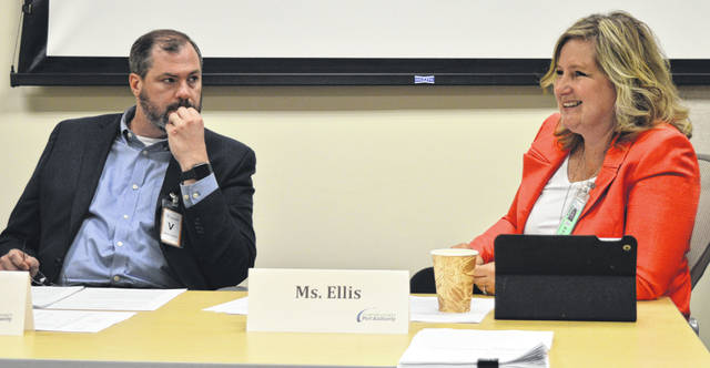 "Upon hearing about Amazon's request for a new airport gate entrance, Clinton County Port Authority board member Beth Ellis, right, said, ""This is a testament to being nimble, right?"" Listening to Ellis is Port Authority board member Jim West."