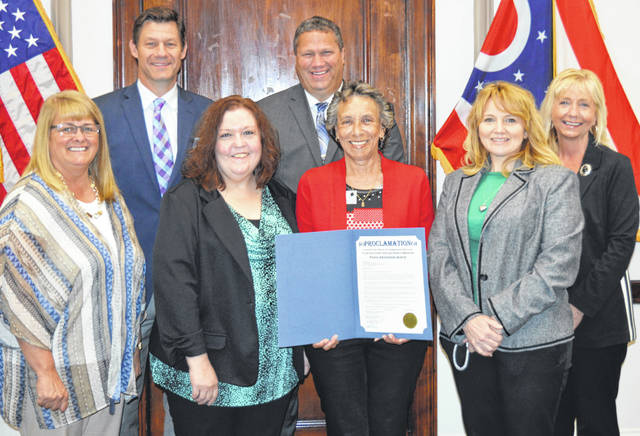 May is proclaimed Public Assistance Fraud Awareness Month in Clinton County on Monday. From left in the front are Clinton County Commissioners President Brenda Woods, Clinton County Job and Family Services staffers Renea Moore, Kate Reeder and Chris Smith; and from left in the back are Clinton County Commissioners Kerry Steed and Mike McCarty, and Job and Family Services Director Kathi Spirk.