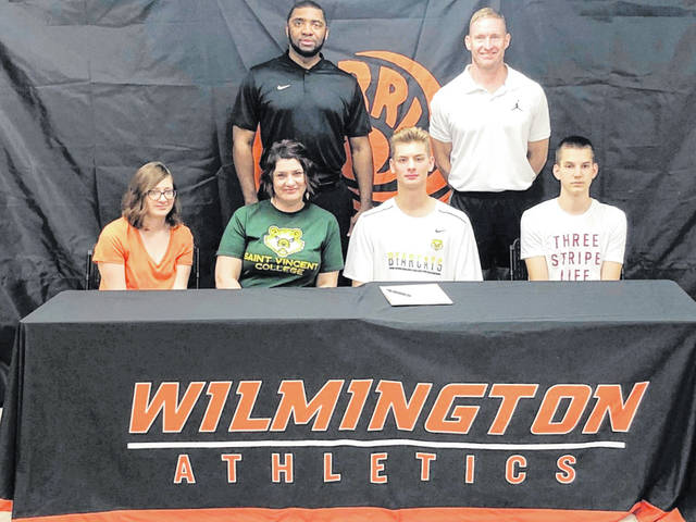 Wilmington High School senior Sam Jacobyansky has chosen Saint Vincent College to play basketball next season. Saint Vincent College is a Division III institution in Latrobe, Pa. Saint Vincent is a member of the Eastern College Athletic Conference. In the photo, from left to right, Ruth Jacobyansky, Shannon Jacobyansky, Sam Jacobyansky, Marko Anicic; back row, Terrance Smith, SVC head coach, and Michael Noszka.