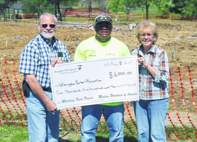 From left are Dan Mayo, Modern Woodmen District Agent; Jermaine Isaac, Park Superintendent; and Bev Mayo, Wilmington Chapter 4288 President.
